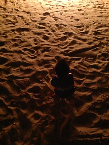 I really like this picture of a little boy in the sand